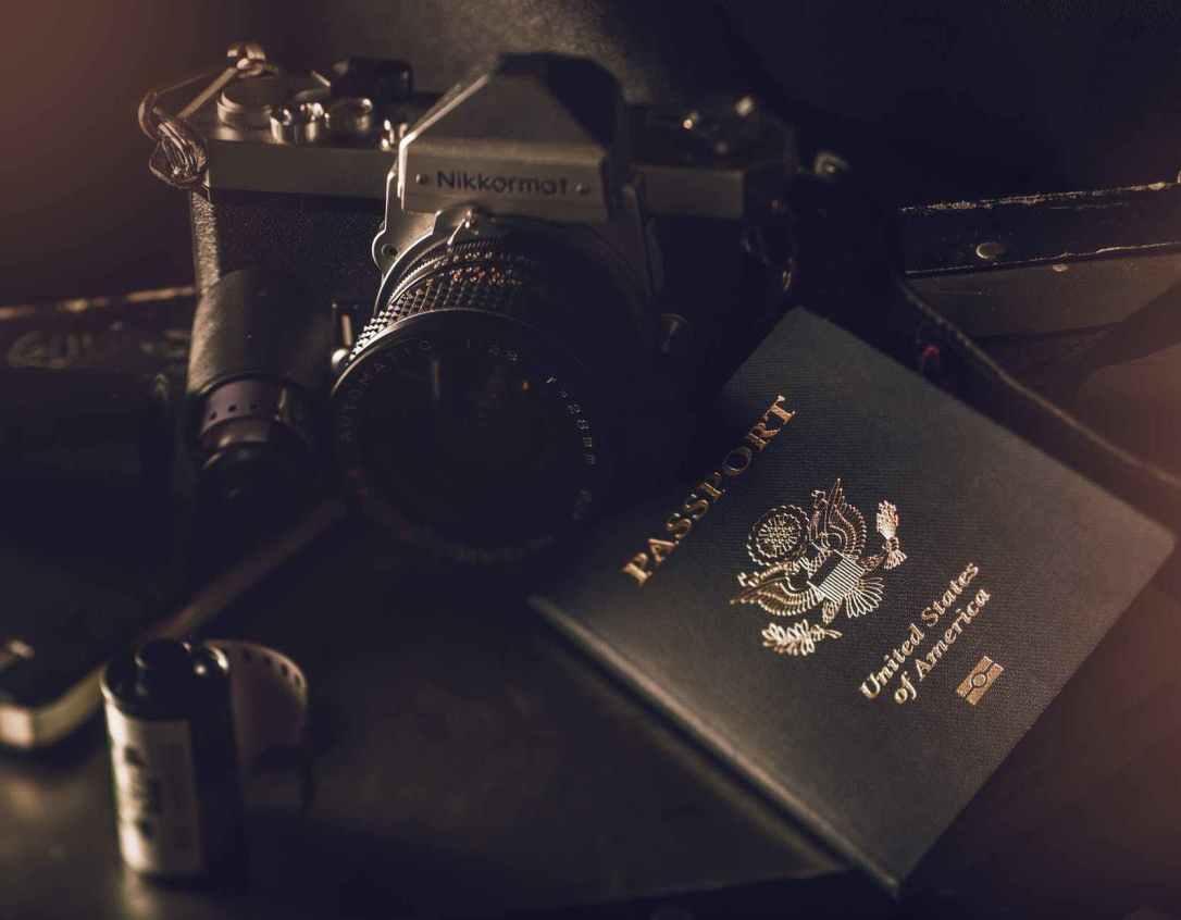 camera beside passport